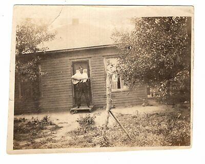 1930s Photo Man Standing in Door of Cottage with a Guitar