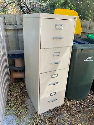 4 drawer filing cabinet office storage in good condition including some files