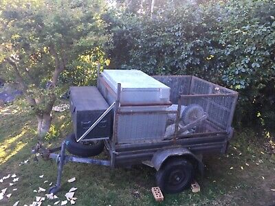 Trailer with attached tool boxes