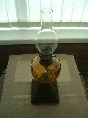 Vintage Single Burner Oil Lamp With Amber Glass Reservoir And Cast Base