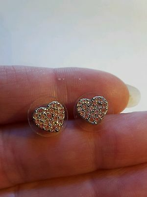 A lovely pair of silver tone heart shaped earrings with clear crystals.