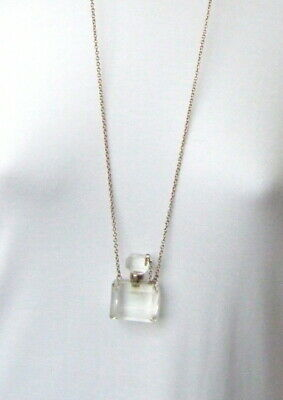 Funky Clear Plastic Perfume Bottle Pendant On A Claspless Gold Tone Chain