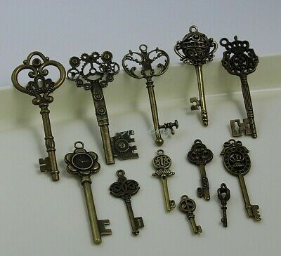 12 Royal Stlyes metal alloy Vintage Skeleton Keys Charm Set Antique Bronze color
