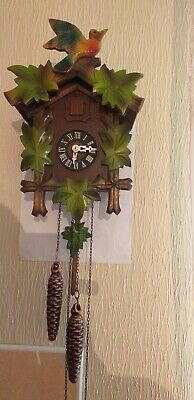 a large black forest cuckoo clock in very good working order
