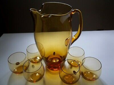 Amber mid-century modern pitcher with 6 small glasses about 4 ounces each