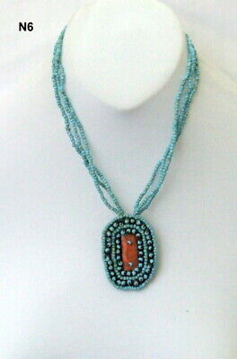 Triple Strand Turquoise Blue Seed Bead Drop Necklace With An Oval Pendant