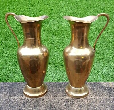Pair of two large antique vintage Art Nouveau solid brass water claret jugs