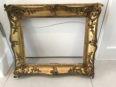 Ornate 19th century gilded  swept picture frame with mouldings