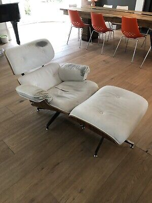 White leather Eames Lounge Chair And Footstool