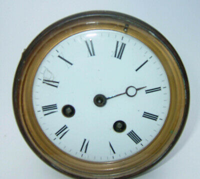 French bell strike clock movement with bezel and dial