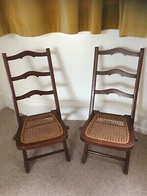 A pair of Edwardian mahogany children's folding chairs with ladder backs