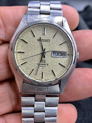 Vintage Seiko Quartz Day Date 600610 Gold Silver Black Mens Wrist Watch Works