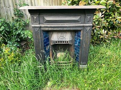 Edwardian cast iron fireplace surround and insert with original blue tiles