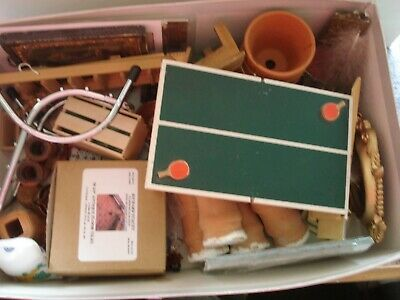 box of used vintage dolls house items