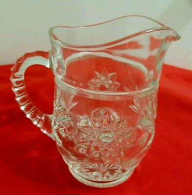 Small Pressed Glass Pitcher With Star & Starburst Pattern Ribbed Handle