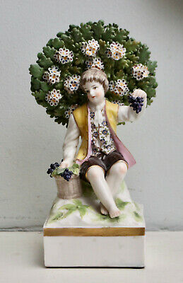 A Charming Antique Porcelain Figure, Boy with Grapes Sitting before Bocage