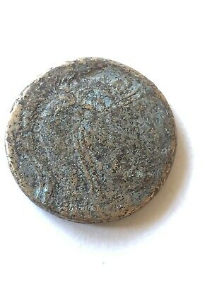 Ancient Greek bronze coin of Amisos. Perseus holding Medusa's head. Nice example