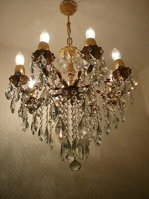 Vintage 8 Arm Brass and Crystal Old Chandelier.