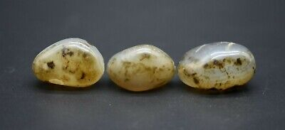 Group of 3 antique Near Eastern translucent stone beads