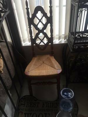 Beautiful antique chair with woven seat.
