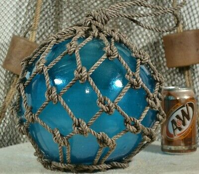 Vintage Glass Fishing Float In Aqua With A Blue Tint