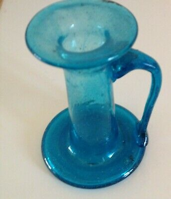 Taller blue glass candlestick in good condition