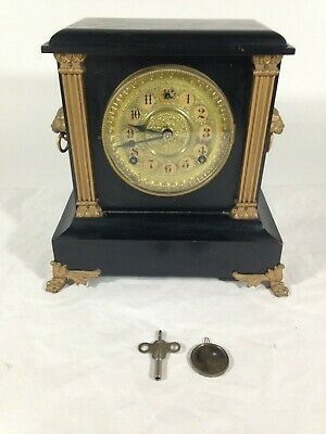 Antique Wood Base S.F. Shelf Mantle Clock With Lion Heads