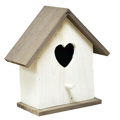 White wooden bird nest box house with heart shaped entrance hole