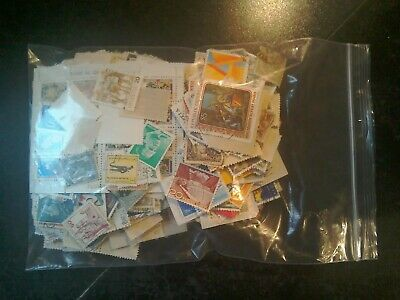 103g unsorted World Stamps off paper Kiloware