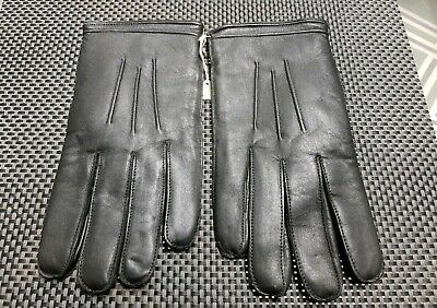 A pair of Vintage leather gloves, still pinned together size 9 1/2, Unused.