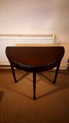 Antique folding card table in dark wood