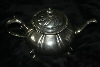 Metal Tea Pot Purchased from Harrods in London. Needs a shine but looks Fabulous