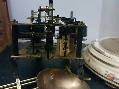German brass double strike clock movement  spares or repair and large glass dome