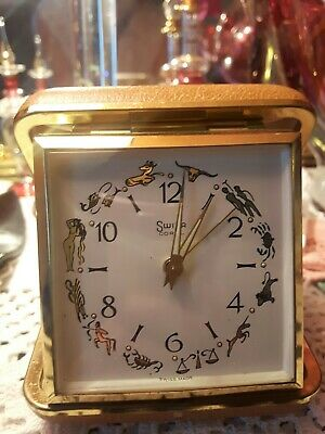 Vintage Swiza Swiss Travel Alarm Clock with Signs of Zodiac in gold gilt finish