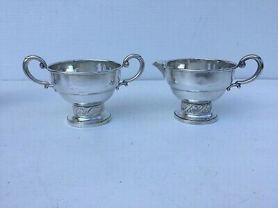 Pair of Floret hallmarked sterling silver decorative and ornamental containers