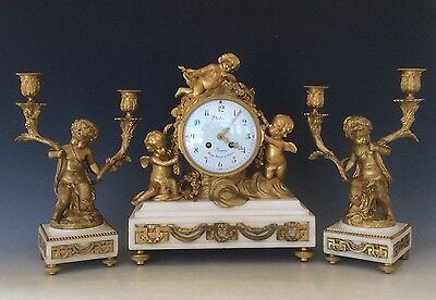 French Bronze Clock Garniture with Cherubs on Marble stand Circa 1880