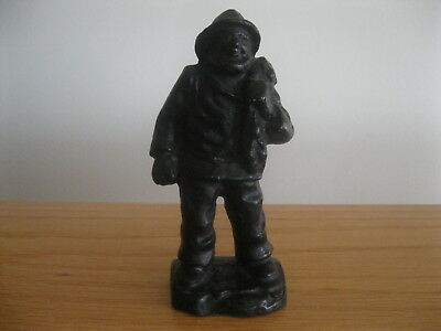 "Cast iron fisherman carrying his bounty 6-1/2"" tall black color"