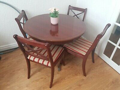 Extendable Mahogany dining table and 4 chairs