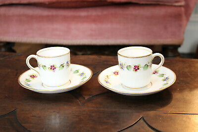 A Pretty Pair of Antique Hand Painted Cups and Saucers