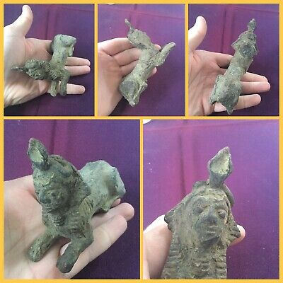 Very rare ancient Egyptian sitting pharaoh animal bronze offering, c 300-500 bc