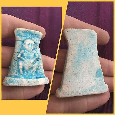 Rare ancient Egyptian blue faience figure against panel amulet, 300 bc