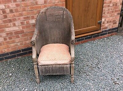 Old Antique Wicker Chair With Wooden Legs And Wood To Front Of Arms