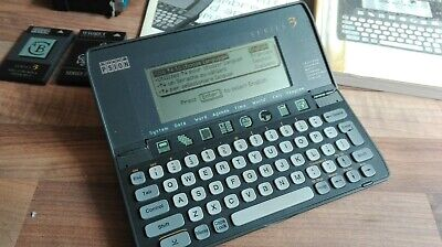 Psion Series 3 PDA + cartridges and cable