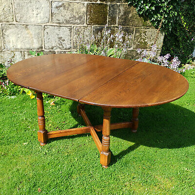 C17th Country Style Round to Oval Solid Oak Extending Kitchen Dining Table