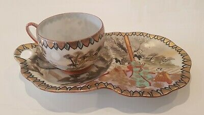 Superb Antique Japanese porcelain tea cup and integrated saucer tray signed