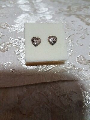 A Pair Of Silver Heart Shaped Earrings