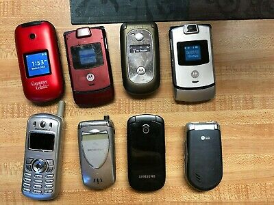 8 Vintage Motorola razor flip phones and others.