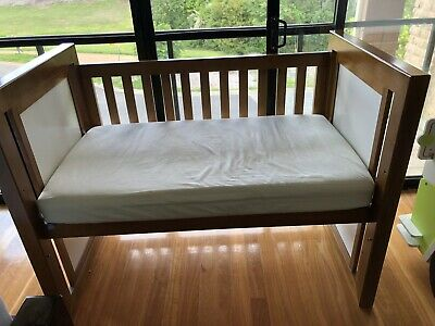 As new cot with change table( mattress accessories included)