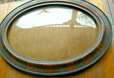 Antique oval tiger stripe picture frame with convex bubbleglass in VeryGoodCond.