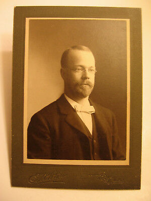 Two  photos of gentlemen. One cabinet views and one in folder from England